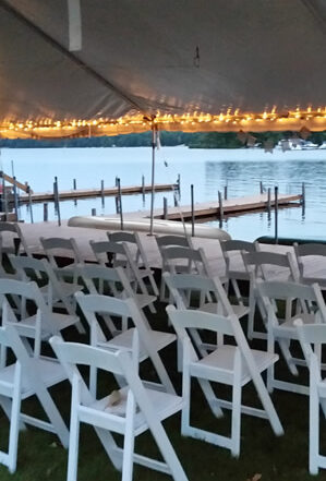perfect small wedding ceremony location under white tent at the water's edge