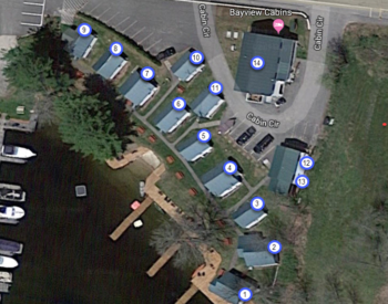 birds eye view of cabins arranged by lake with labels showing number and capacity