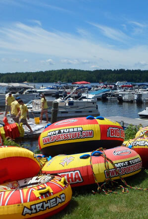bright orange and yellow water tubes and lots of motorboats at the local marina